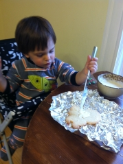 Frosting the now traditional Christmas pulpo.