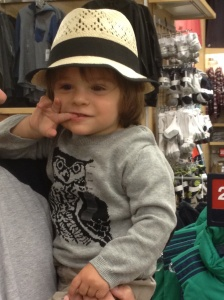 Straw fedora and owl sweater. You're never too young to accessorize.