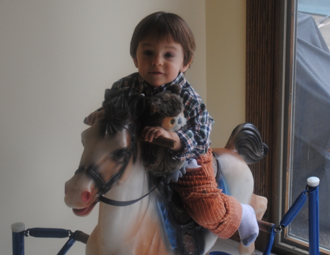 Das Big Boy and Big Boy Owl (his real name) ride Spotty Horsey, who was mine when I was a child. Thanks, La Gigi!