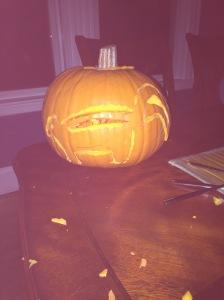 Herr Husband, 2014 Skunk-o-lantern Knife in pumpkin.