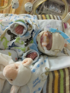 In the outfit our friends sent while I was on hospital bedrest. Look at how big that preemie outfit is on him!
