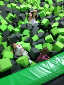 Shown here is Hipster Hausfrau hurling foam blocks at her gleeful children in the foam pit.